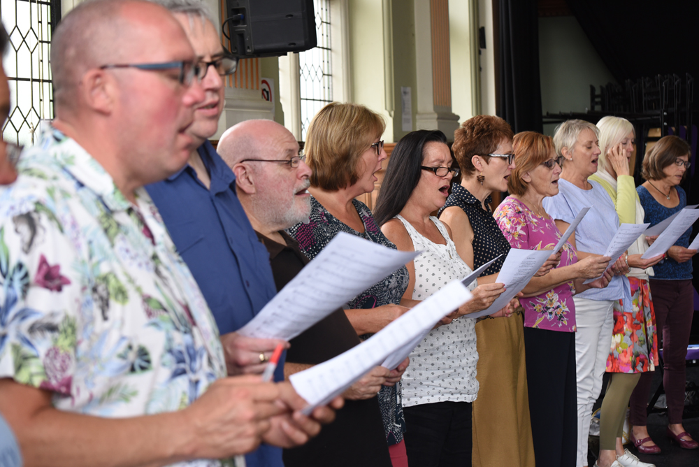 Singers aged 55 and over rehearsing for a Sea Folk Sing performance