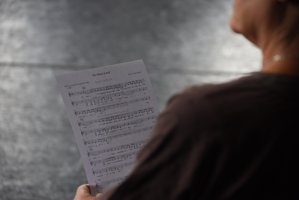 Looking over a singer's shoulder at the musical score for Sea Folk Sing.