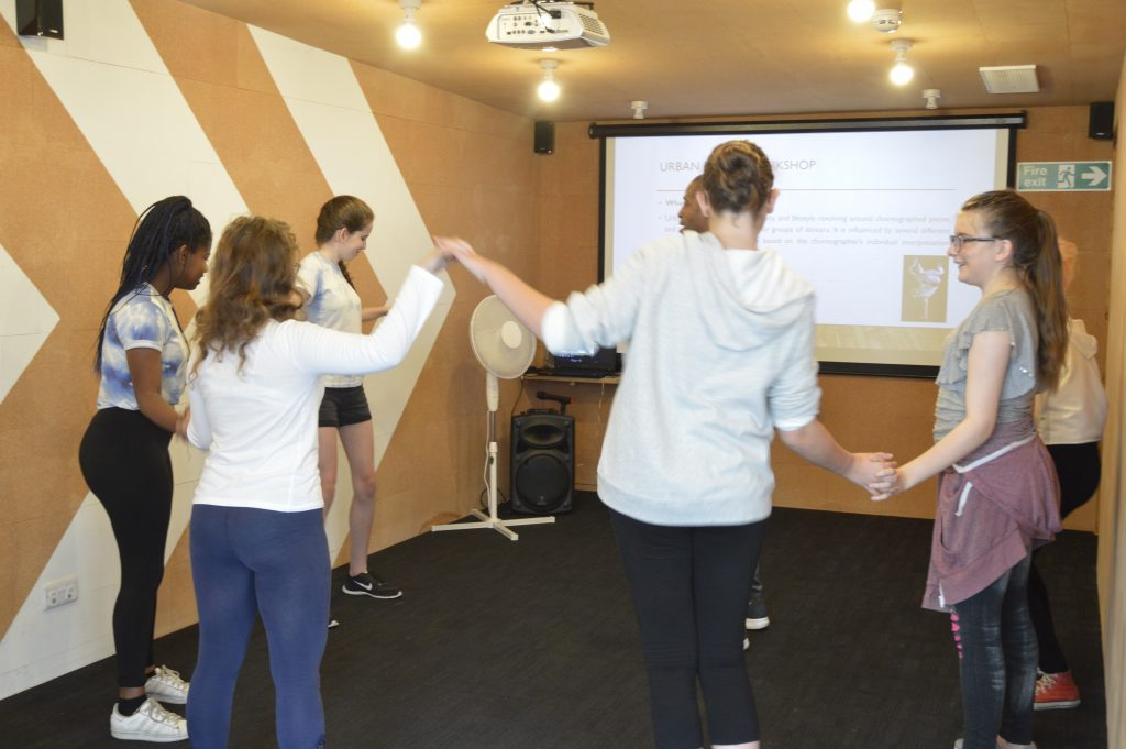 Group learning the wave dance move