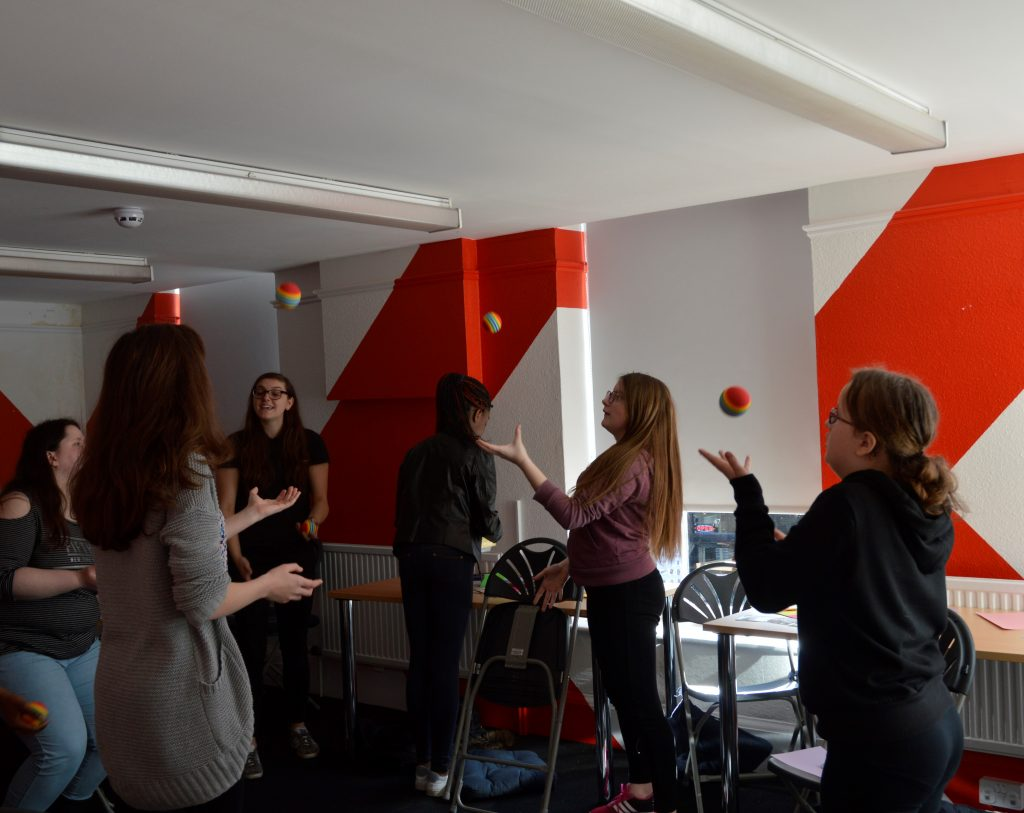 Young people learning to juggle
