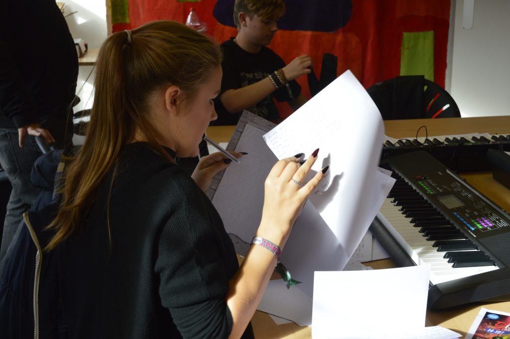 Young person making notes for Arts Award